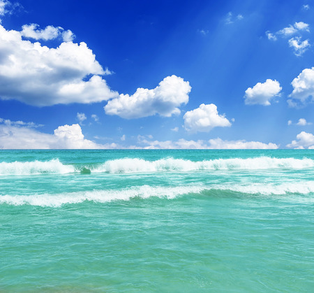 Blue sea and clouds in blue sky photo