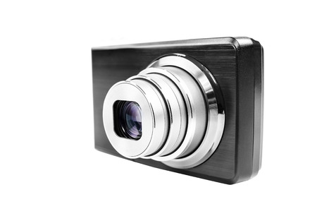Compact digital camera isolated over white background photo