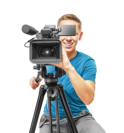 Video camera operator smile and working with his professional equipment isolated on white background Stock Photo