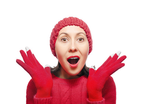 Surprised Woman Wearing Winter Hat and Gloves photo