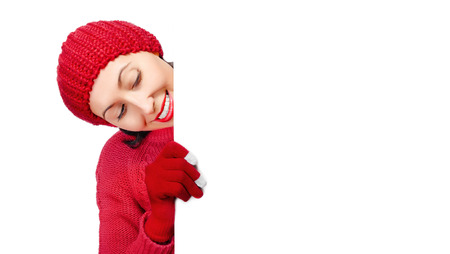 Girl in winter clothes showing a blank banner photo