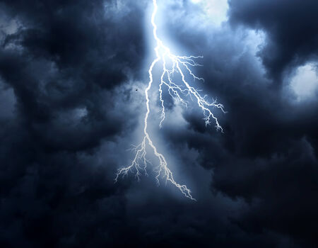 A lightning strike on the cloudy sky