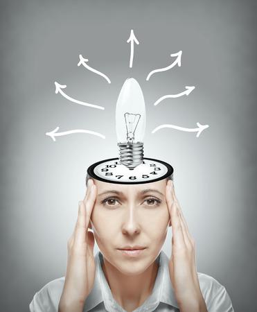 generates: Woman generates the idea of hard thinking. Stock Photo