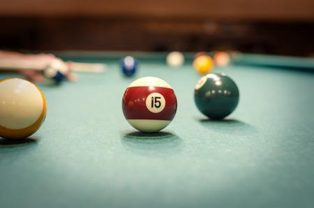 handcarves: Playing billiard - Close-up shot of a man playing billiard