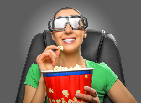 viewer: Viewer watching 3D cinema in spectacles with bowl full of popcorn. Stock Photo