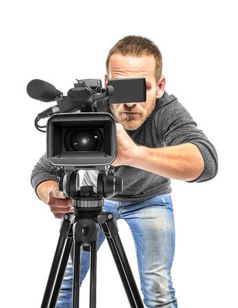 Video camera operator filmed. Isolated on white background. Foto de archivo