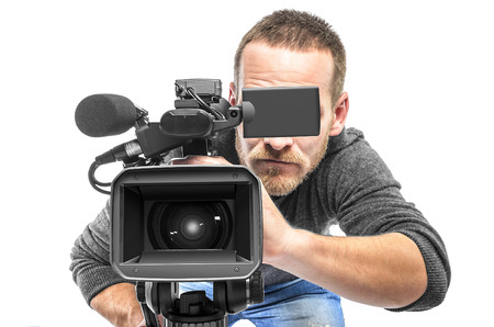Video camera operator filmed. Isolated on white background. Archivio Fotografico