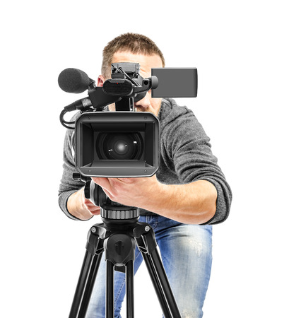 Video camera operator filmed. Isolated on white background. Foto de archivo