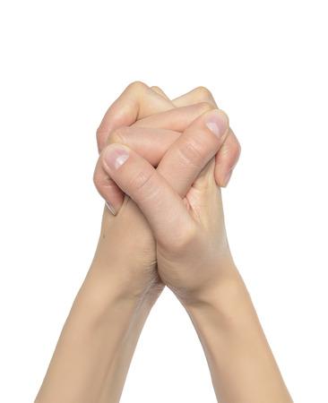 manos orando: Manos de rogaci�n de una mujer, aislado en blanco. Foto de archivo