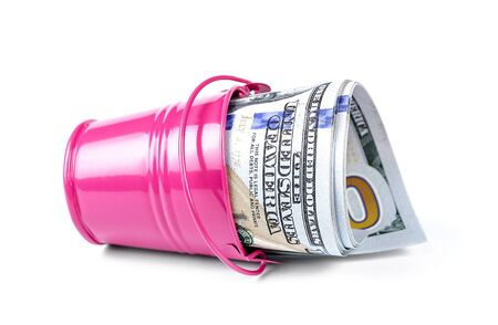 bucket of money: Money in a pink bucket, isolated over white background.