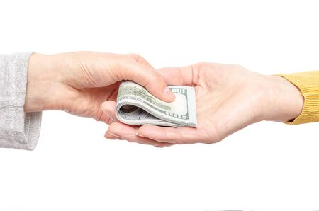 Hand giving money to other hand isolated on white. photo