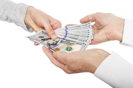 lend a hand: Hand giving money to other hands isolated on white. Stock Photo