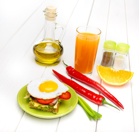 Traditional French Toasted Sandwich with fried eggs and juice photo