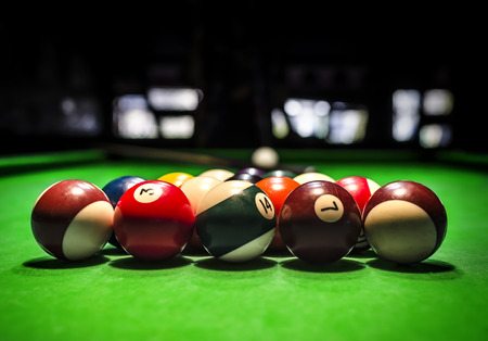 snooker halls: Billiard Balls. A Vintage style photo from a billiard balls in a pool table. Noise added for a film effect