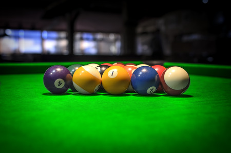 billiards halls: Billiard Balls. A Vintage style photo from a billiard balls in a pool table. Noise added for a film effect