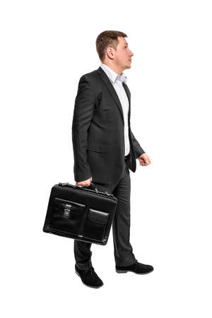 brief case: Going business man holding brief case over wite Stock Photo
