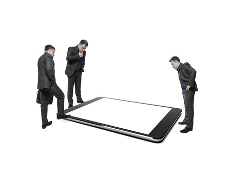 counsel: Businessmen take counsel, looking at huge display of tablet computer. On a white background. Conceptual image. Stock Photo