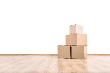 moving up: Empty room with boxes on the floor. Stock Photo