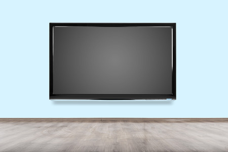 Empty room with HD TV at the wall. photo
