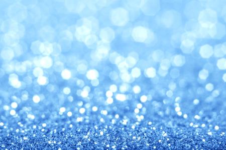 추상 파란색 반짝이 배경. 반짝 반짝이 나뭇잎 크리스마스 배경입니다.