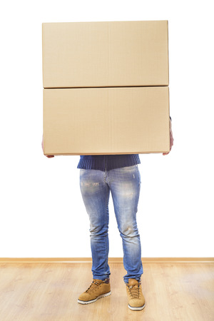 first time buyer: Man with box moving into new room. Stock Photo