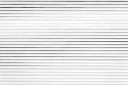 security shutters: White metal roller door shutter background and texture