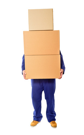 warehouse worker: Man with stacked boxes isolated on white.