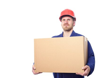20 24 years: Construction worker holds heavy carton box. Isolated on white.