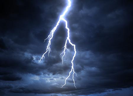 A lightning strike on the cloudy sky photo