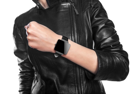 Smart watch. Isolated female body with black smart watch on hand. photo