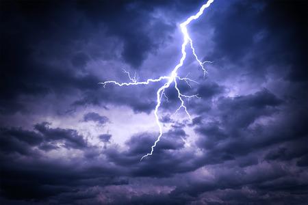 Lightning strike on the dark cloudy sky