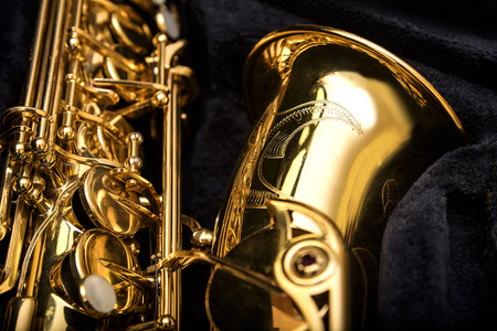 Saxophone detail against the background of a velvet cover photo