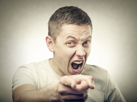 wail: Portrait of young angry man points finger. Instagram Style. Stock Photo