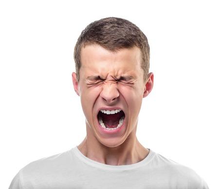 visage d homme: Portrait de jeune homme en colère. Isolé sur blanc. Banque d'images