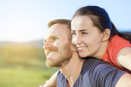 Couple in love at sunset smiling enjoy outdoor pastime. photo