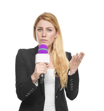 Report important news attractive blonde TV presenter holding a microphone. Isolated on white background. photo