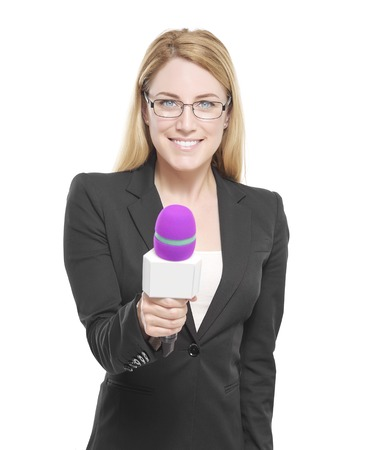 Attractive blonde TV presenter in glasses holding a microphone. Isolated on white background.