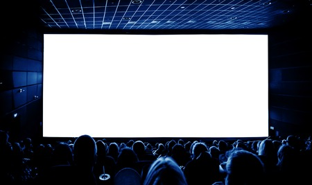 back screen: Cinema. The audience in 3D glasses watching a movie. A white screen for your image. Stock Photo