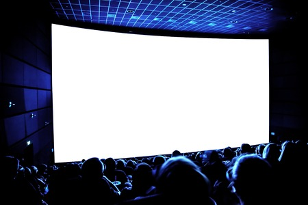 Cinema. The audience in 3D glasses watching a movie. A white screen for your image. 스톡 콘텐츠