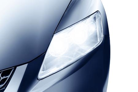 predatory: Predatory car headlight and hood of powerful sports blue car.
