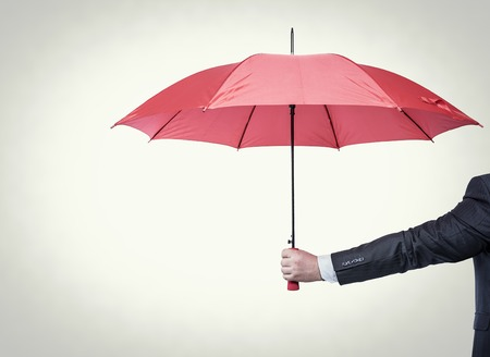 Opened red umbrella in hand, toned photo. Stock Photo - 42135428