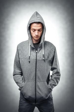 sweatshirt: Young man in stylish sweatshirt. Toned photo.