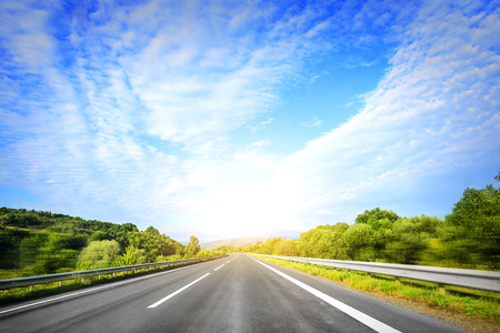 Highway outside the city at sunset. Travel or transportation concept.