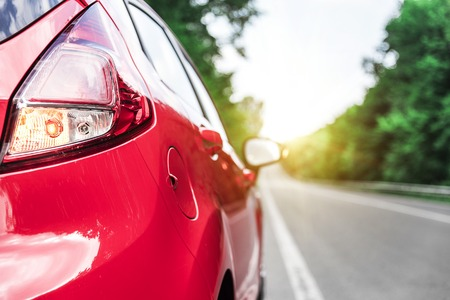 New red car on the road. Travel concept. Stock Photo
