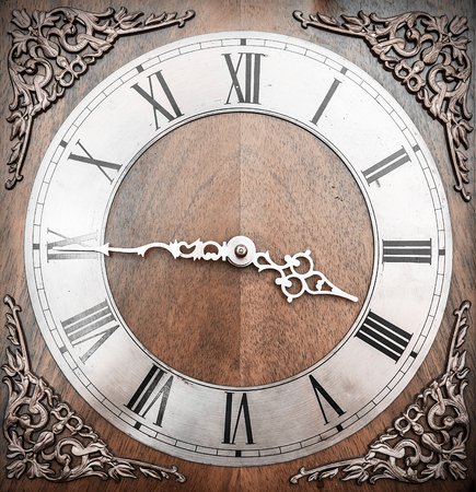 wooden clock: Vintage wooden clock with grunge texture. Time concept.