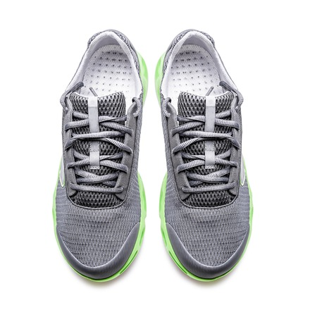 sporting equipment: Unbranded modern sneakers isolated on a white background. Top view. Stock Photo