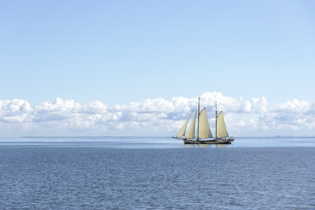 brig: Sailing ship in the open blue sea. Stock Photo