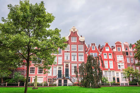 fronts: Odd Classic Brick Houses in Amsterdam, Holland. Stock Photo