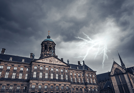 lightning strike: Lightning strike on a cloudy sky over the ancient building.