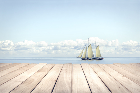 ocean floor: Wooden platform and yacht. Soft toned photo.